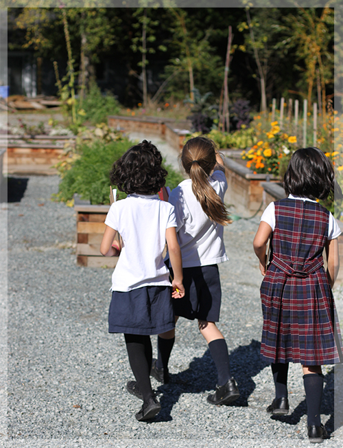 Students walking to the school's garden.